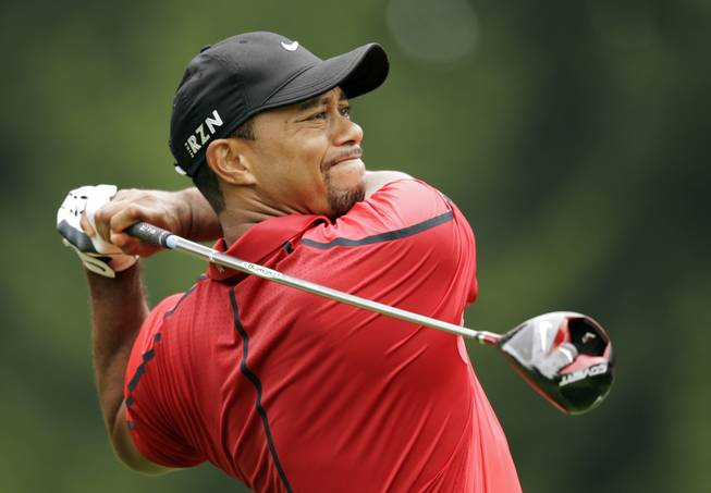 Tiger Woods watches his his tee shot on the fourth hole during the final round of the Bridgestone Invitational golf tournament Sunday, Aug. 3, 2014, at Firestone Country Club in Akron, Ohio.