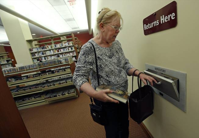 "Susan McNamara returns a book to the public library in Quincy, Mass. ""Over the years, all I've been able to do, especially as a single parent, is just pay your bills every month,"" said McNamara, a 62-year-old adjunct professor from the Boston area. ""Anything that's left over is used up when your car breaks down or when the furnace breaks down ... There's never anything left over, ever."""