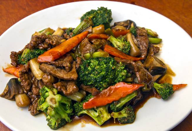 Beef and Broccoli dish by Chef Ivo Karkaliev now cooking Chinese food for the Cafe Fiesta at Fiesta Henderson on Monday, July 28, 2014.   L.E. Baskow