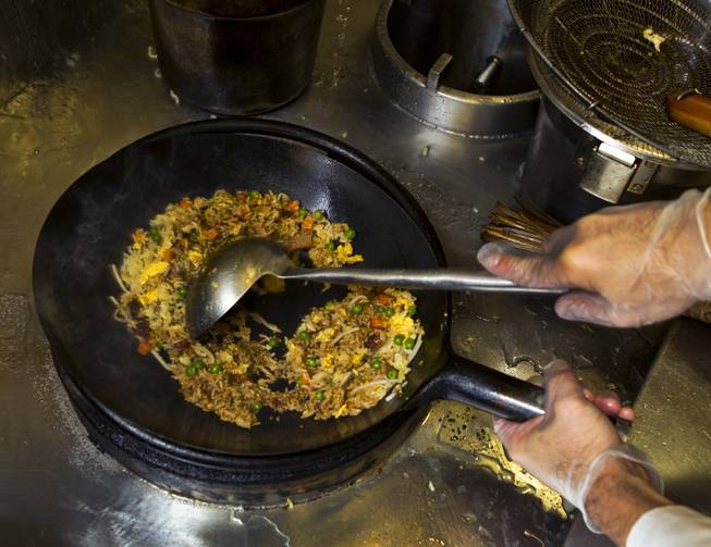 Chef Andy Vu cooks Fried Rice while preparing Chinese food for the Cafe Fiesta at Fiesta Henderson on Monday, July 28, 2014.   L.E. Baskow