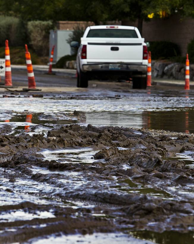 Heavy rains have caused serious flooding and piles of mud to collect along West Grand Teton Drive at the intersection of North Tenaya Way on Monday, August 4, 2014.