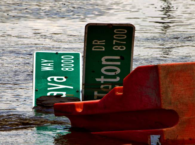 Heavy rains have caused serious flooding along West Grand Teton Drive at the intersection of North Tenaya Way on Monday, August 4, 2014.