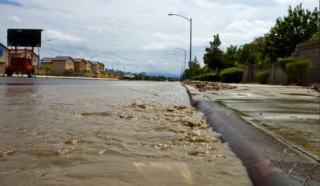 Flooding still continues from recent heavy rains along West Grand Teton Drive at the intersection of North Quail View Street on Monday, August 4, 2014.