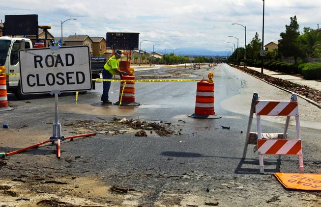Roads are closed as flooding continues from recent heavy rains along West Grand Teton Drive at the intersection of North Quail View Street on Monday, August 4, 2014.