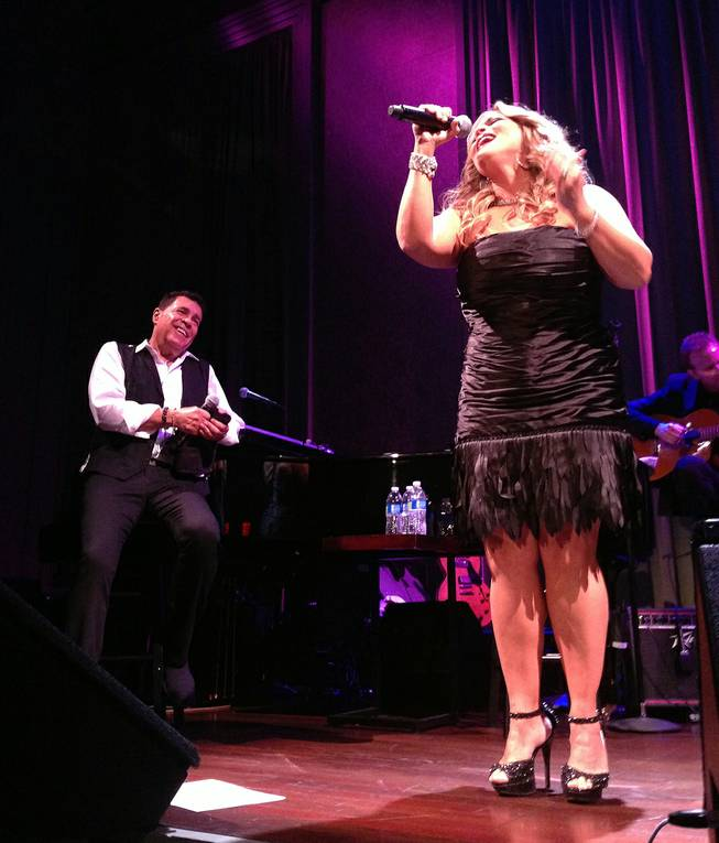 Clint Holmes is shown with special guest Elisa Fiorello, who has performed as a backing vocalist for Prince, at Cabaret Jazz at the Smith Center on Sunday, Aug. 3, 2014.