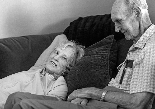 In this July 2014 photo provided by their granddaughter Melissa Stone, Don Simpson, 90, and his wife Maxine, 87, share time together in Sloan's home in Bakersfield, Calif. The couple, married 62 years, died four hours apart July 21, 2014, while lying next to each other, their family said.