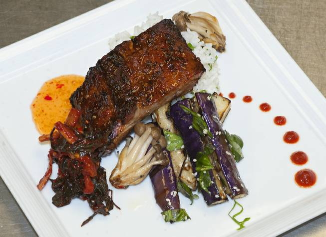 Lemongrass pork sparerib with grilled sesame is pictured, served with Japanese eggplant, cilantro sticky rice, roasted mushrooms and kimchi dish prepared by Chef Rob at Cafe DiVine inside the Springs Preserve.