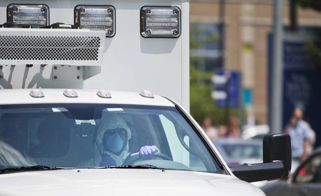 An ambulance transporting Nancy Writebol, an American missionary stricken with Ebola, arrives at Emory University Hospital, Tuesday, Aug. 5, 2014, in Atlanta.