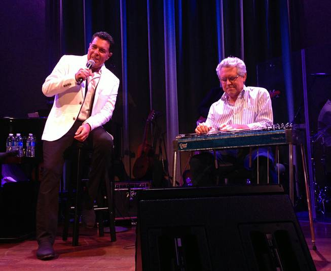 Clint Holmes, left, performs with slide-guitar artist Joel Ferguson at Cabaret Jazz at the Smith Center on Sunday, Aug. 3, 2014.
