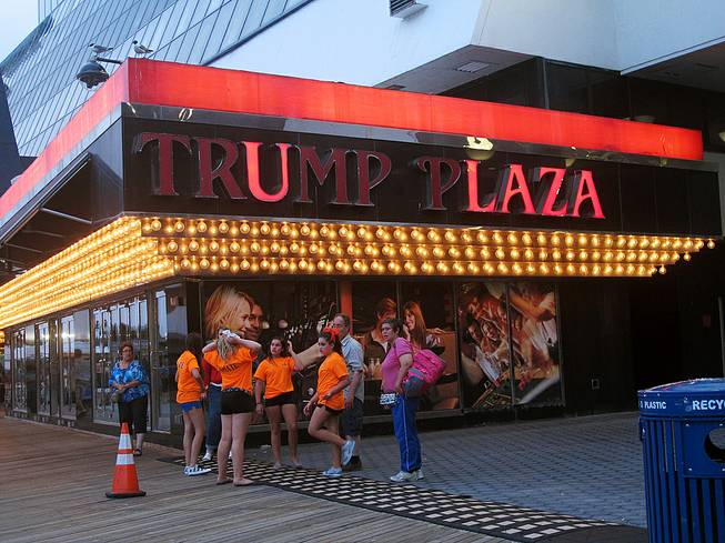 This July 24, 2014, photo shows several lights burned out in the illuminated facade of the Trump Plaza Hotel Casino in Atlantic City, Tuesday Aug. 5, 2014.