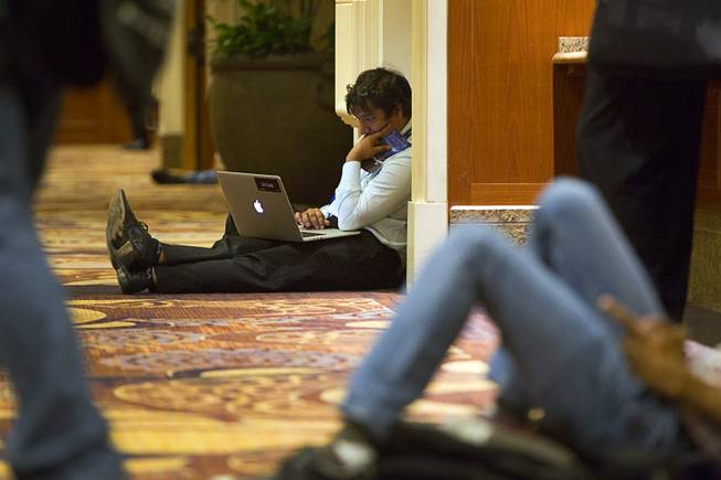 Utkarsh Sanghi, a security engineer at Google, works in a hallway during the Black Hat USA 2014 hacker conference at the Mandalay Bay Convention Center Aug. 6, 2014.