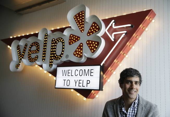 In this photo taken Friday, Aug. 1, 2014, Yelp CEO Jeremy Stoppelman poses at his company's headquarters in San Francisco.