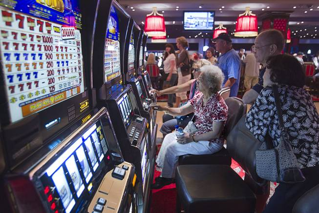 Gamblers try their luck with slot machines during the opening of the casino floor at the Cromwell, formerly Bill's Gamblin' Hall & Saloon, on the Las Vegas Strip and Flamingo Avenue, Monday, April 21, 2014.