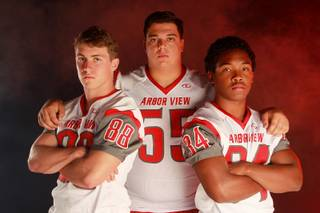 Arbor View High School football players Mitchell Durkee, Malik Noshi and Herman Gray on Monday,  July 21, 2014.