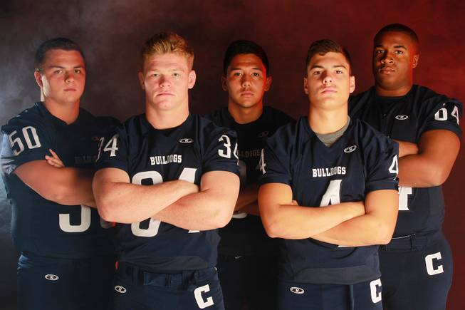 From left, Centennial High School football  players Andrew Miller, Hunter Brown, Joseph Ceniseros, Nick Humenick and Jordan Lewis July 21, 2014.