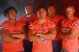Bishop Gorman High School football players Noah Tialavea, Alize Jones, Nela Otukolo, Jackson Perry and Jabari Butler on Monday, July 21, 2014.