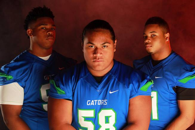 From left, Green Valley High School football  players Cordell Tidwell, Tafe Vete and Larry Norman July 21, 2014.