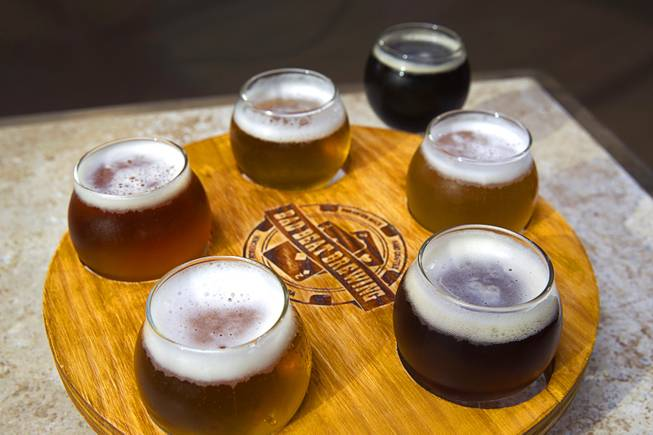 "A sampler of beers is shown at Bad Beat Brewing, 7380 Eastgate Rd., a brewery in Henderson's ""Booze District,"" Thursday, August 7, 2014."