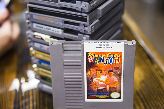 "Classic Nintendo games are stacked on a counter at Bad Beat Brewing, 7380 Eastgate Rd., a brewery in Henderson's ""Booze District,"" Thursday, August 7, 2014."