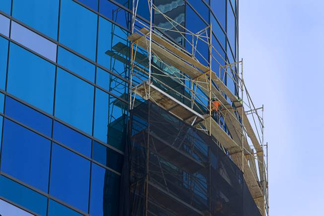 Scaffolding is shown along the exterior of the Harmon tower in MGM Resorts' CityCenter on Thursday, Aug. 7, 2014. The 26-floor tower, deemed structurally unsound, will be demolished piece by piece.