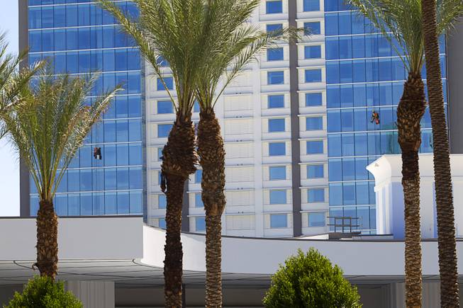 Window washers work at the SLS Las Vegas Thursday, August 7, 2014. The new resort, formerly the Sahara, will open on August 23.