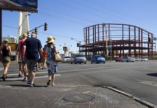 Tourists pass by construction at the northeast corner of Sahara Avenue and Las Vegas Boulevard South on Thursday, Aug. 7, 2014. A Walgreens will occupy about half of the first floor. Wilger Enterprises is the general contractor on the project.
