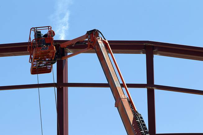 A Valley Steel iron worker welds during construction of a building at the northeast corner of Sahara Avenue and Las Vegas Boulevard South Thursday, August 7, 2014. A Walgreens will occupy about half of the first floor. Wilger Enterprises is the general contractor on the project.