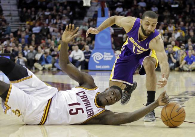 The Cleveland Cavaliers' Anthony Bennett (15) bats a loose ball away from the Los Angeles Lakers' Kendall Marshall in the fourth quarter of an NBA basketball game on Wednesday, Feb. 5, 2014, in Cleveland.