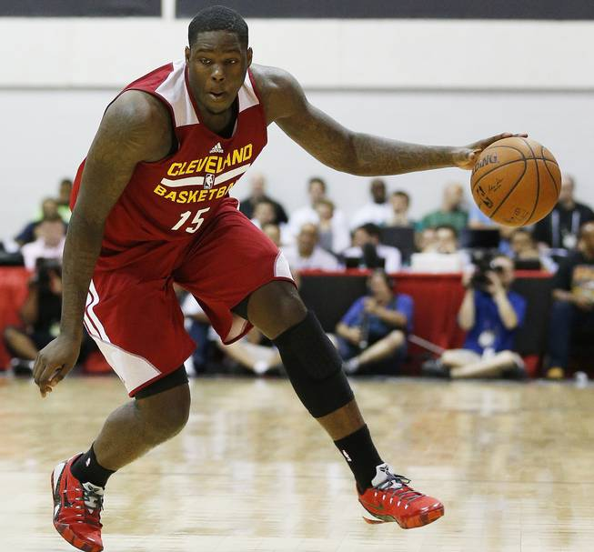 In this July 11, 2014, file photo, Cleveland Cavaliers' Anthony Bennett drives toward the basket against the Milwaukee Bucks in an NBA summer league basketball game in Las Vegas.