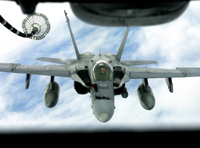 "An FA 18 Hornet approaches to get airborne refueling from a KC 10 Tanker of U.S. Airforce 2nd Air Refuelling Squadron, based in Andersen Air Force Base in Guam, during the ""Valiant Shield 06"" exercises in the Pacific Ocean, off Guam coast,  Friday, June 23, 2006."