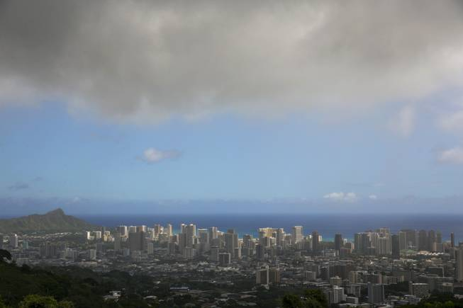 Clouds hang over Honolulu, seen from the top of Tanalus Drive on Thursday, Aug. 7, 2014, before  Tropical Storm Iselle makes landfall on Friday, Aug. 8, 2014. Tracking close behind it is Hurricane Julio.