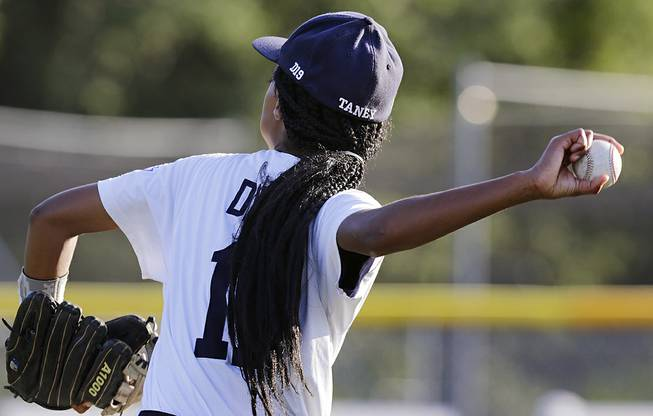 In this Aug. 6, 2014, photo, Pennsylvania pitcher Mo'Ne Davis follows through on a throw prior to facing the District of Columbia in the Little League Eastern Regionals at Breen Stadium in Bristol, Conn.