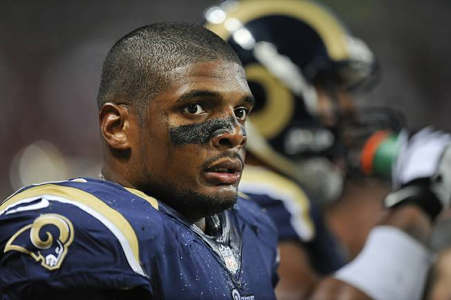 St. Louis Rams defensive end Michael Sam watches from the sideline in the second quarter of a preseason NFL game between the Rams and the New Orleans Saints on Friday, Aug. 8, 2014, in St. Louis.