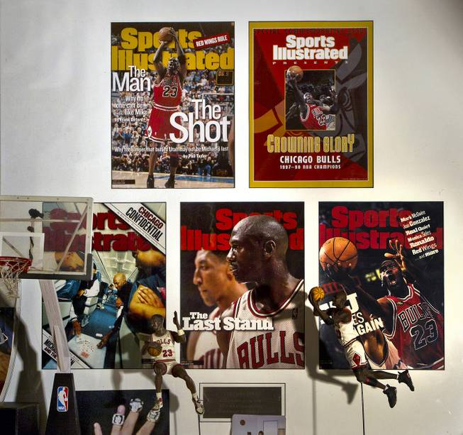 Cesar Flores was pleased to have this framed Michael Jordan collection of Sports Illustrated covers, Flores originally from Chicago and a big Bulls fan on Friday, August 8, 2014.