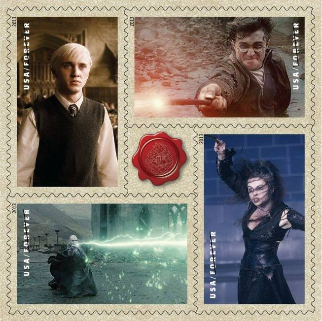 "This image released by the United States Postal service shows a variety of ""Harry Potter"" themed Forever stamps, clockwise from top left, Tom Felton as Draco Malfoy, Daniel Radcliffe as Harry Potter, Helena Bonham Carter as Bellatrix Lestrange and Ralph Fiennes as Lord Voldemort. The USPS dedicated 20 new Forever stamps, Tuesday, Nov. 19, 2013, at Universal Orlando Resort in Florida."