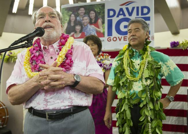 Hawaii Governor Neil Abercrombie, left, addresses the supporters of Hawaii State Sen. David Ige as Ige, right, looks on Saturday, Aug. 9, 2014, in Honolulu. Ige defeated Abercrombie in the state's primary election to win the Democratic Party's nomination. Abercrombie, who has spent nearly 40 years in Hawaii politics, is the first Hawaii governor to lose to a primary challenger and only the second not to win re-election.