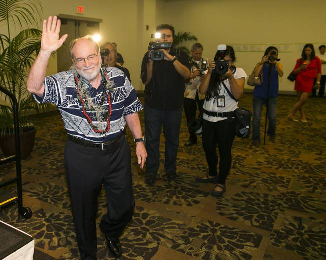 Hawaii Gov. Neil Abercrombie, center, waves to the crowds at the Democratic Unity Breakfast, Sunday, Aug. 10, 2014 in Honolulu. The breakfast is traditionally held after Hawaii elections and is attended by both winners as well as losers. Fellow Democrat and State Sen. David Ige defeated Abercrombie in a stunning primary-election defeat Saturday.
