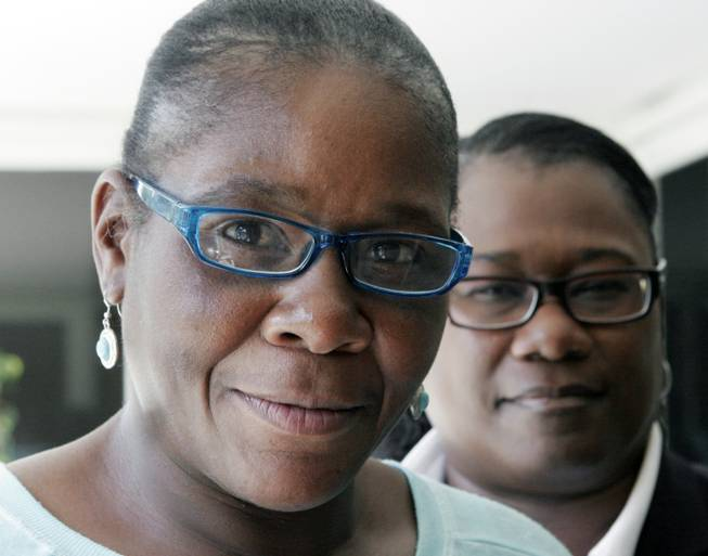 Marlene Pinnock, left, poses with her attorney, Caree Harper during an interview Sunday Aug. 10, 2014 in Los Angeles. Pinnock, a homeless woman was beaten by a CHP officer in July 2014. Sunday was Pinnock's first publicized interview since the incident, that was videotaped.