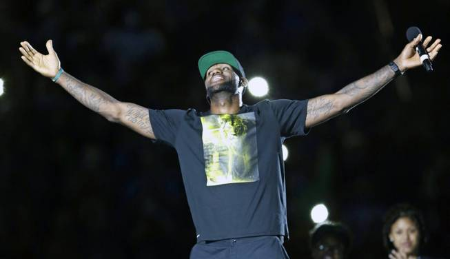 Cleveland Cavaliers' LeBron James smiles as he is introduced at his homecoming at InfoCision Stadium Friday, Aug. 8, 2014, in Akron, Ohio.
