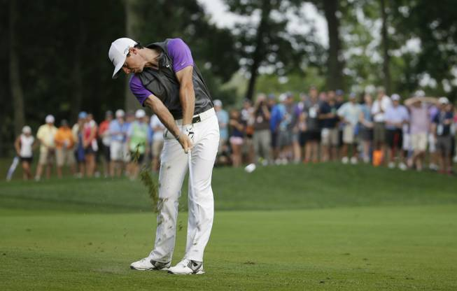 Rory McIlroy hits from the fairway on the 12th hole during the final round of the PGA Championship golf tournament at Valhalla Golf Club on Sunday, Aug. 10, 2014, in Louisville, Ky.