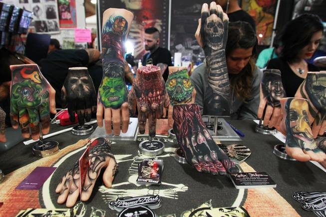 Rubber hands and feet, used for practice and display, are seen at the Pound of Flesh booth at the 3rd annual Art-N-Ink Tattoo Festival Saturday, Aug. 9, 2014 at the South Point.