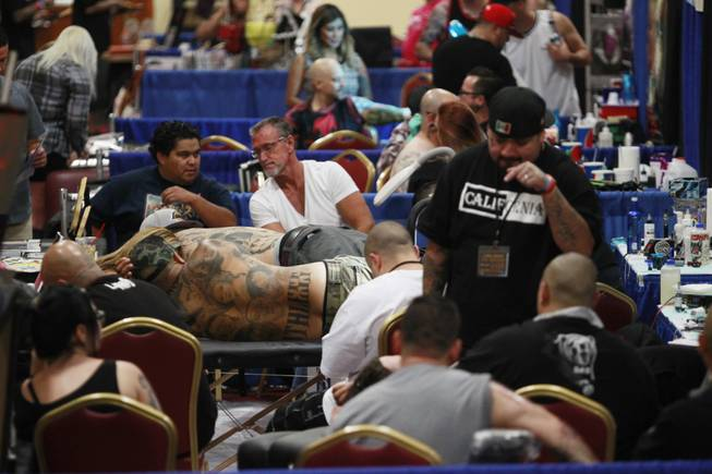 Tattoo artists and aficionados take part in the 3rd annual Art-N-Ink Tattoo Festival Saturday, Aug. 9, 2014 at the South Point.