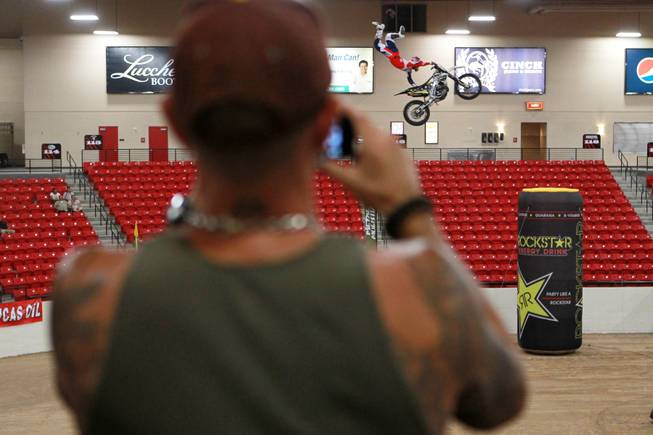 A rider sails through the arena during Metal Mulisha freestyle motocross demonstration at the 3rd annual Art-N-Ink Tattoo Festival Saturday, Aug. 9, 2014 at the South Point.