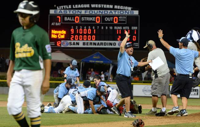 Nevada players and coaches celebrate after defeating Pacifica 11-2 Saturday night to win the Little League Western Regional Championship.  Mountain Ridge Little League, from Las Vegas, Nevada, defeated Pacifica Little League 11-2 Saturday August 9, 2014 in the Little League Western Regional Championship game at Al Houghton Stadium in San Bernardino. Nevada will play at the Little League World Series in Williamsport, PA. starting next week.  (Will Lester/Staff Photographer)