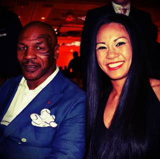 Las Vegas boxer, MMA star and inductee Ana Julaton, with Mike Tyson, attends the 2014 Nevada Boxing Hall of Fame ceremony at the Tropicana on Saturday, Aug. 9, 2014, in Las Vegas.