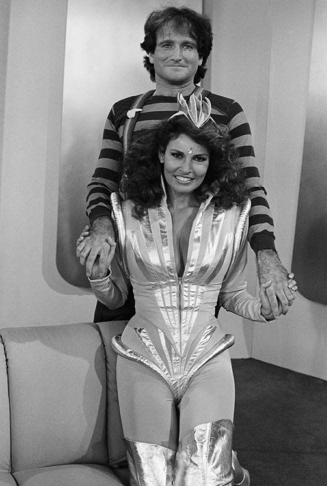 "Actress Raquel Welch, front, dressed for her role as Capt. Nirvana, a sinister figure from another planet, with Robin Williams, star of ABC's ""Mork and Mindy,"" on Nov. 13, 1979."