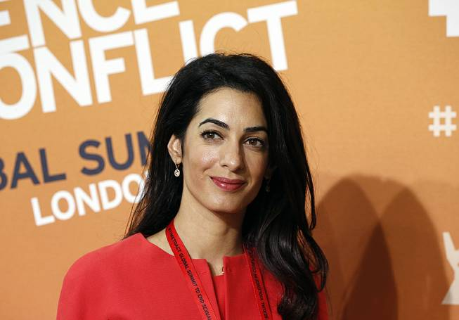 "Amal Alamuddin, human rights lawyer and fiancee of actor George Clooney, attends the ""End Sexual Violence in Conflict"" summit in London, June 12, 2014. Alamuddin has pulled out of an appointment to serve on the U.N.'s three-member commission of inquiry looking into possible violations of the rules of war in Gaza."