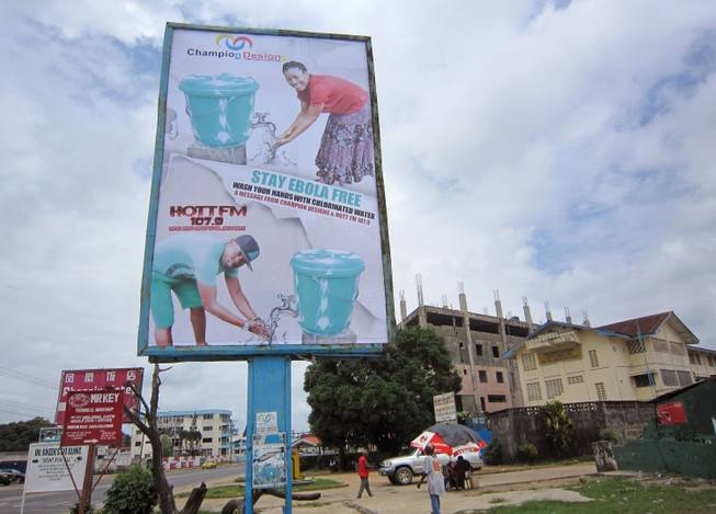 In this image taken Saturday, Aug. 9, 2014, a large billboard promoting the washing of hands to prevent the spread of the deadly Ebola virus in Monrovia, Liberia.