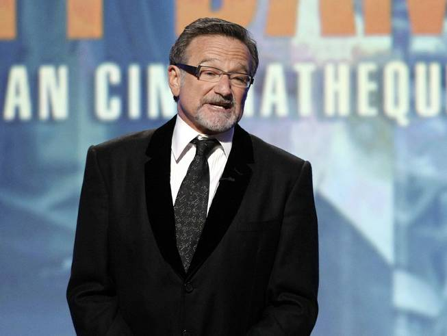 This March 27, 2010, file photo shows actor Robin Williams speaking at the 24th American Cinematheque Awards honoring Matt Damon in Beverly Hills, Calif. Williams has died in an apparent suicide.