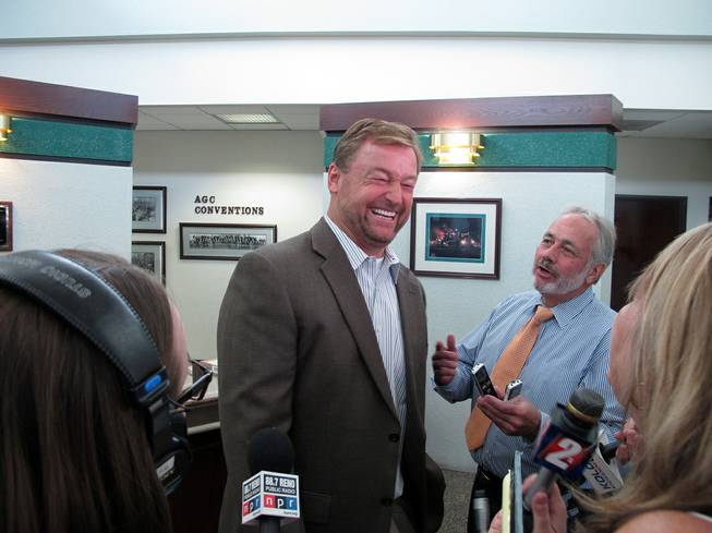 Sen. Dean Heller laughs with reporters Monday, Aug. 11, 2014, after meeting with a transportation roundtable sponsored by the Association of General Contractors at Granite Construction in Sparks. Among other things, he discussed efforts to lure Tesla Motors' $5 billion lithium batter plant to Nevada.